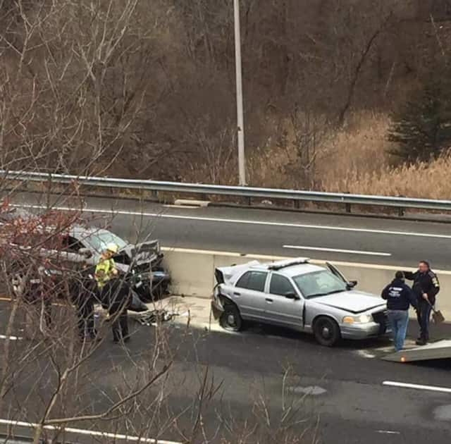 A Connecticut state trooper was rear-ended while helping a stranded vehicle on Route 7.