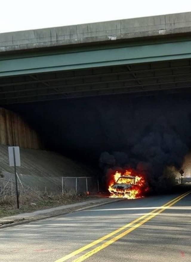 Flames consume car Thursday under Route 80 at Ridgefield Park/Bogota border.