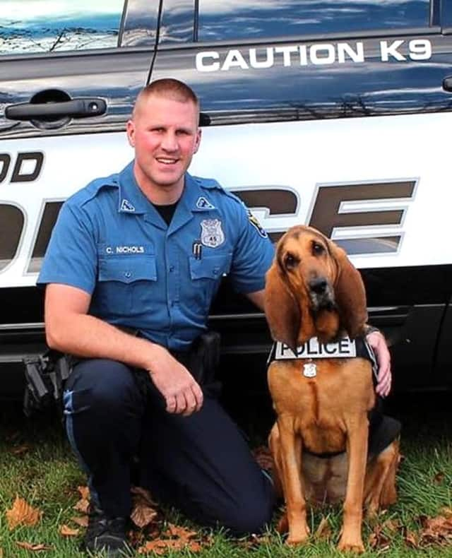 Zoey and her partner, Maywood K-9 Police Officer Chris Nichols.