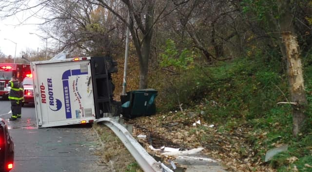 A small box truck rolled over on Martin Luther King Drive in Norwalk on Saturday.