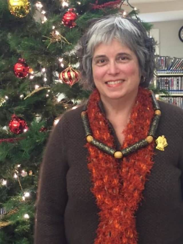 Pat Mack of the Franklin Lakes Library wears her homemade necklace.