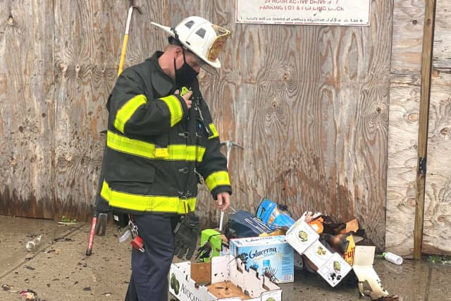 Passaic Battalion Chief John Hayowyk views some of the remains of the afternoon fire.