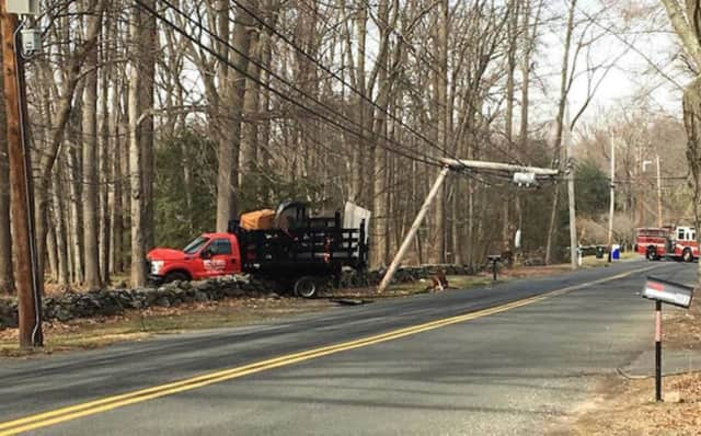 The Fairfield Fire Department responds to a truck crash that took down wires Monday on Burr Street.