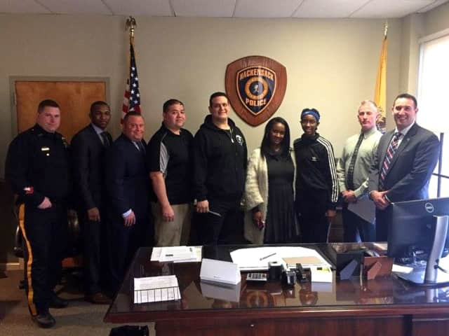 FROM LEFT: Officer Frank McCall, Detective James Travon, Detective James Luther, Detective John Mora, Officer Frank Cavallo, Andrea Kelly, D'monique Kelly, Capt. Patrick Coffey, Detective Mark DelCarpio