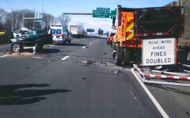 An SUV slammed into a DOT dump truck on I-95 in Bridgeport on Sunday morning.