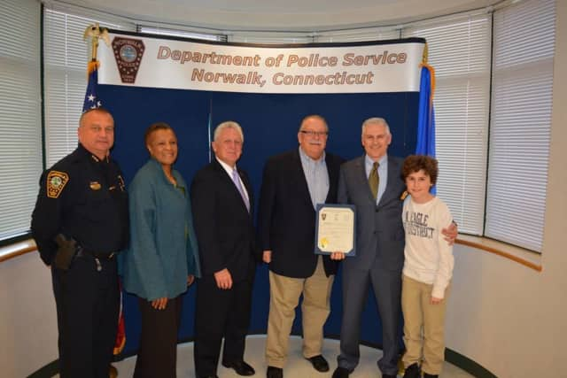 Detective Patrick English (second from right) was recently promoted within the Norwalk Police Department.