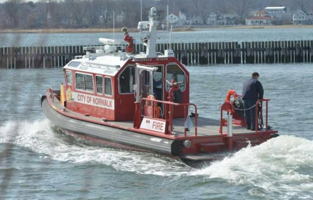 Norwalk firefighters rescued a kayaker who accidentally overturned and was stranded in freezing cold water of Norwalk Harbor.