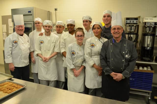 Philip McGrath, left, curriculum chair of the college's Culinary Arts and Management Program, is pictured with his students.