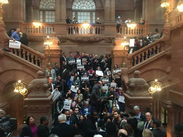 "Advocates for Westchester Children's Association's ""Raise the Age"" campaign, which pushed to raise the age of criminal responsibility young adults from 16 to 18 years old, protested at the New York State Capital Building."