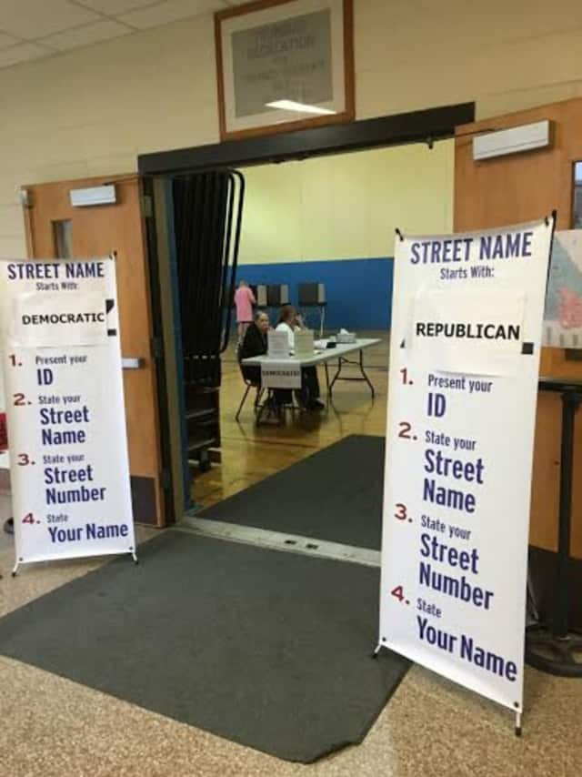 Voters begin to head to the polls Tuesday morning at Madison Middle School in Trumbull.