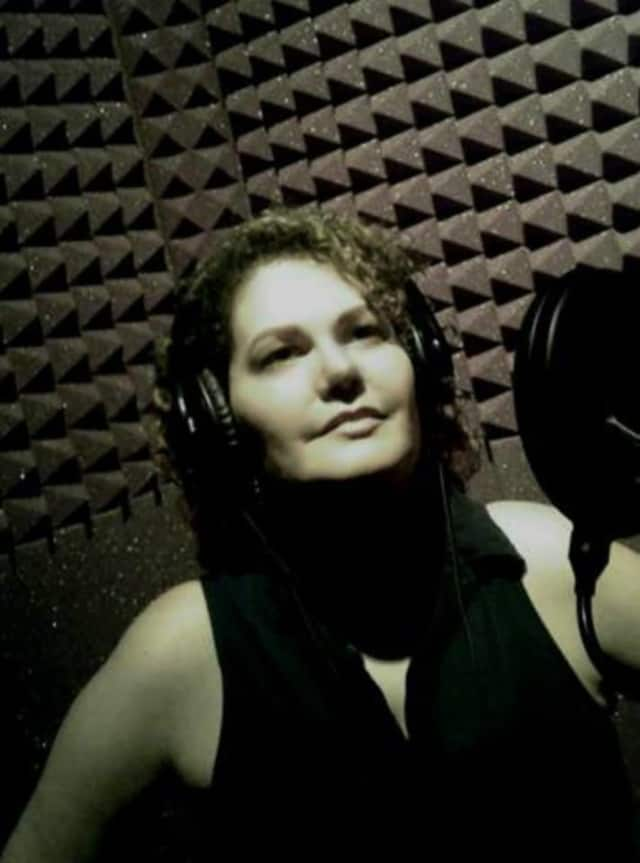 Beacon singer-songwriter Vievanessa in the studio recording her music.