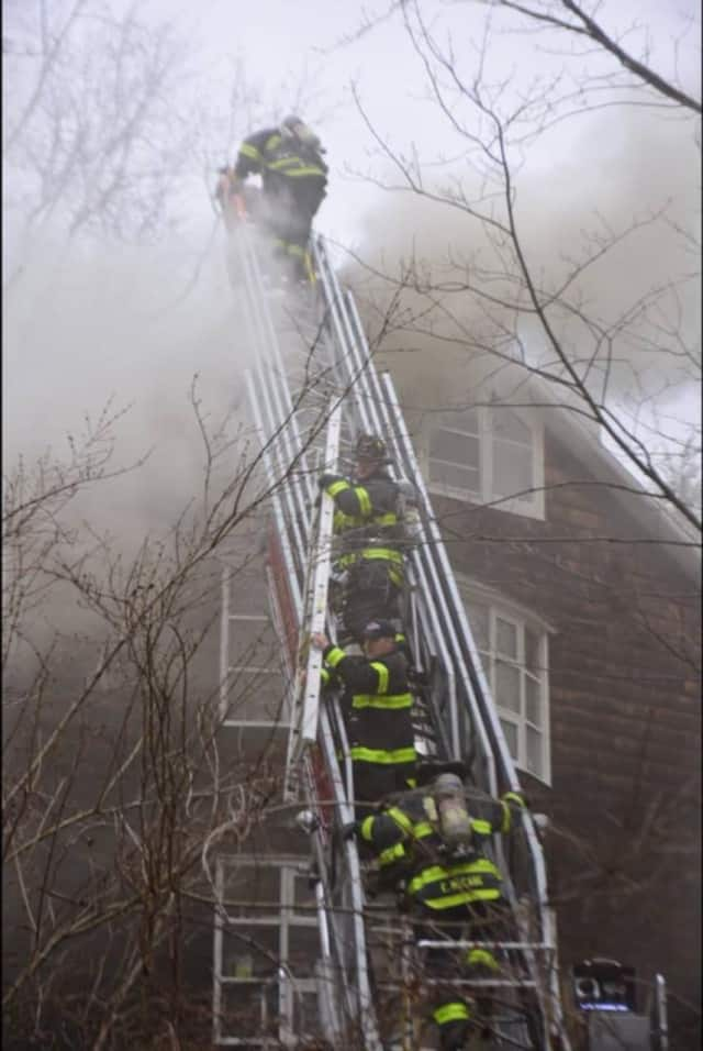 Norwalk firefighters battle a smoky blaze Saturday at 30 West Rocks Road. One man died in the fire.