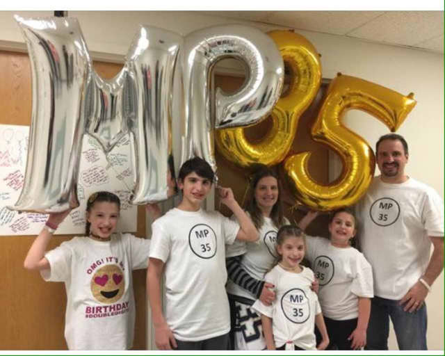 The Polifonte Family wearing Matthew's lacrosse number as they celebrated his and his twin sister's birthday on Monday.