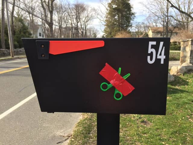 Westport residents have been attaching scissors to their mailboxes with red tape to send a message – don't cut our school budget.