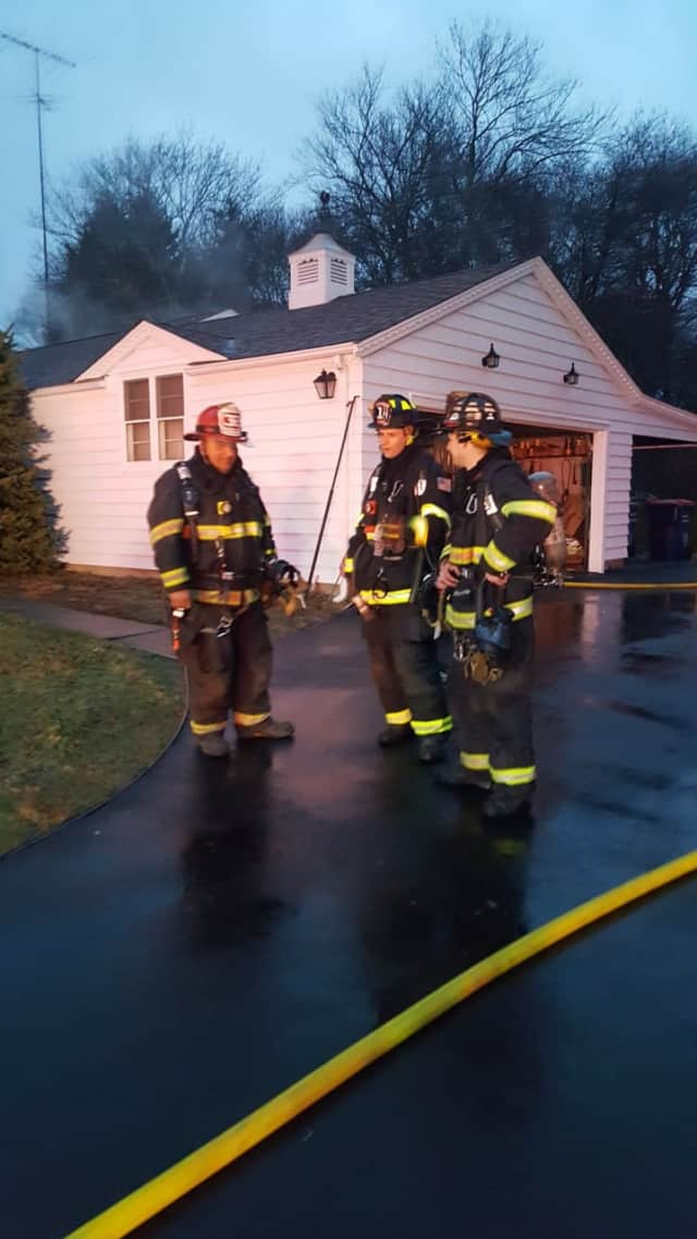 The Long Hill Volunteer Fire Co. responds to a kitchen fire Friday morning in Trumbull.