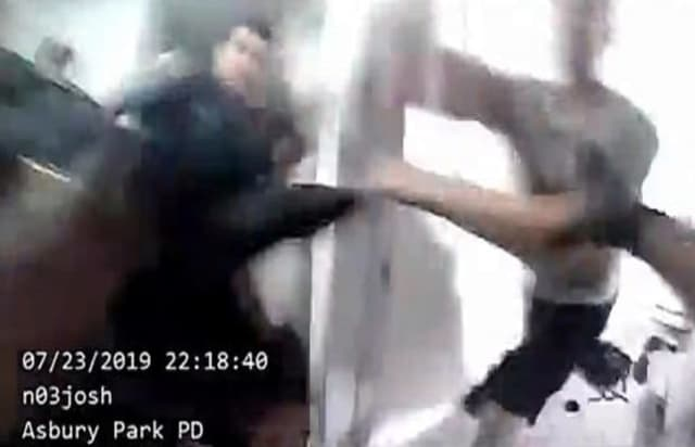 Bodycam footage shows James Manzo charging at Asbury Park police officers with scissors.