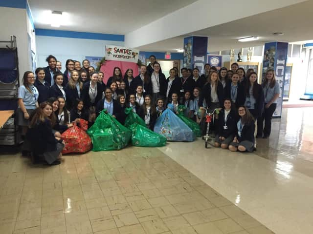 Students assembled at Immaculate Conception High School had a party to wrap the donated toys.