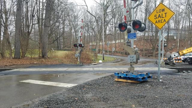 Metro-North is finishing up grade work at two railroad crossings in Redding. The roads reopened as of Thursday morning.