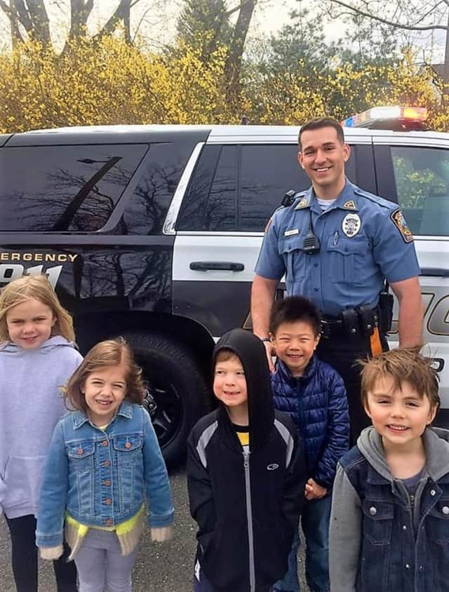 Officer Kreshnick Mahmudi with Eastern Christian Elementary School students.