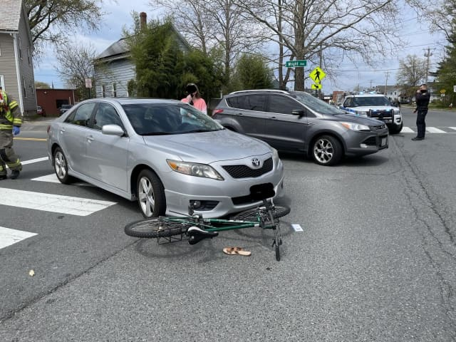 A bicyclist was hospitalized in Western Massachusetts after being struck by a car in a roadway.