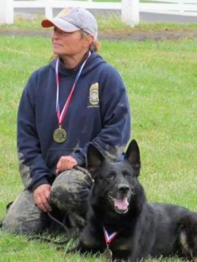 Newtown K9 Officer Saint Michael, shown with his handler Officer Felicia Figol, passed away Sunday. He was recently diagnosed with a rare form of cancer.