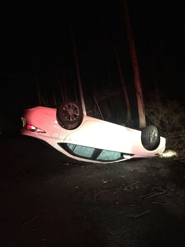 A Connecticut man and his passenger were injured when he lost control of his car, flipping it in Red Hook.