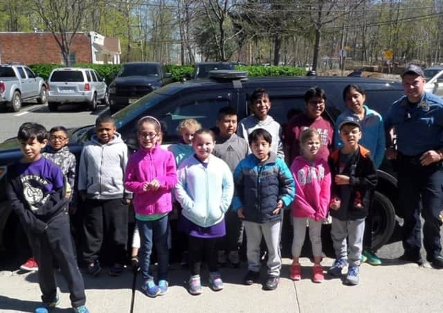 Park Ridge Police Officer Michael Lange with East Brook students after a tour of headquarters.
