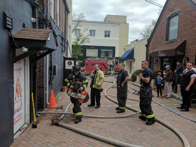 Greenwich firefighters respond to a small fire Sunday on Greenwich Avenue.