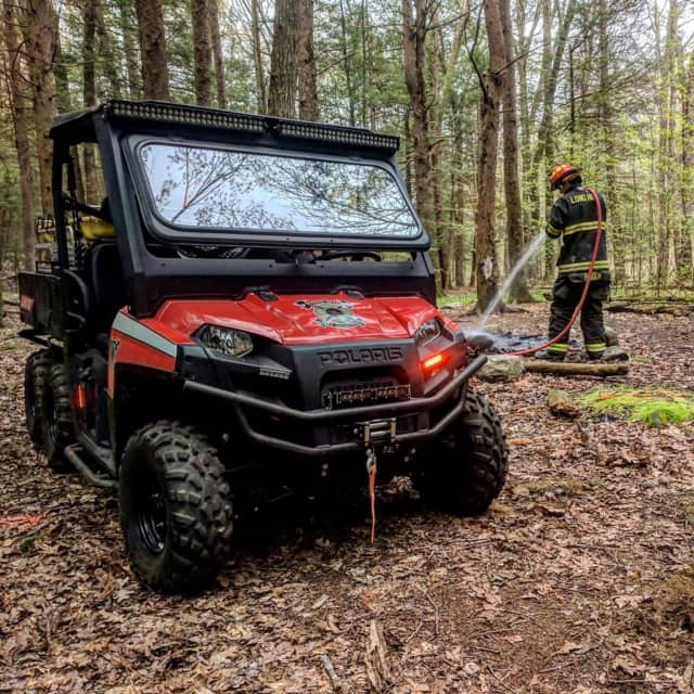 The Polaris is put to use by a firefighter from the Long Hill Volunteer Fire Department to put out an unattended campfire on Sunday in Trumbull.