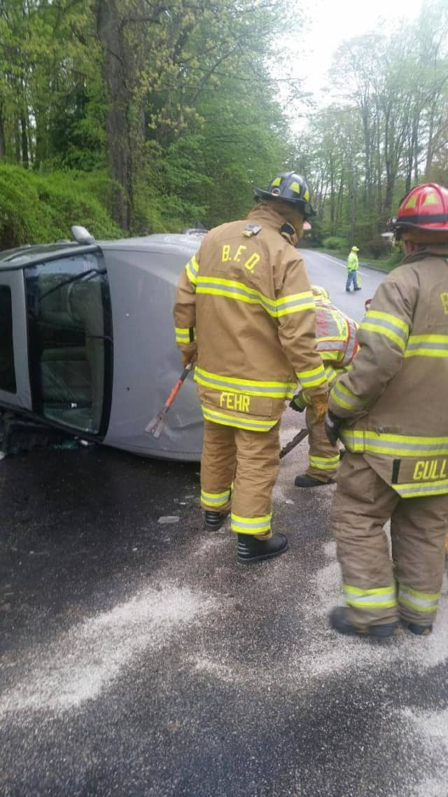 Crews from Bethel respond to an overturned vehicle.