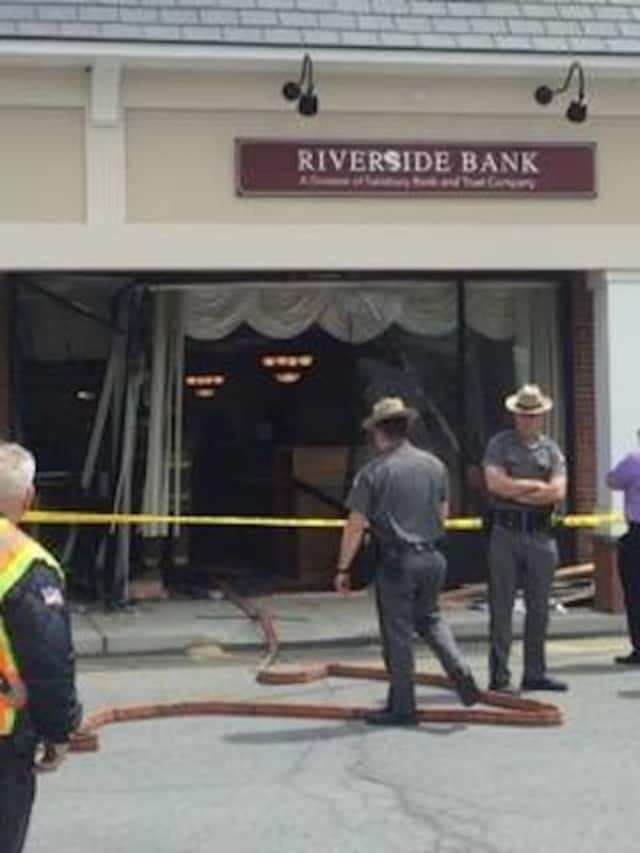 A car plowed through the front of Riverside Bank in the Village of Fishkill causing heavy damage.