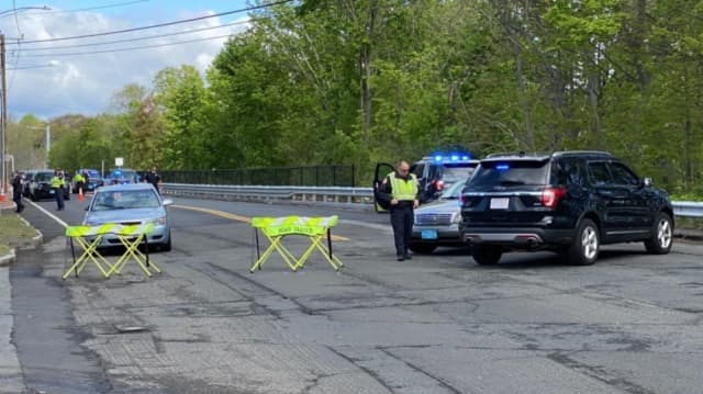 An officer from the Agawam Police Department was hospitalized after being struck by a vehicle.