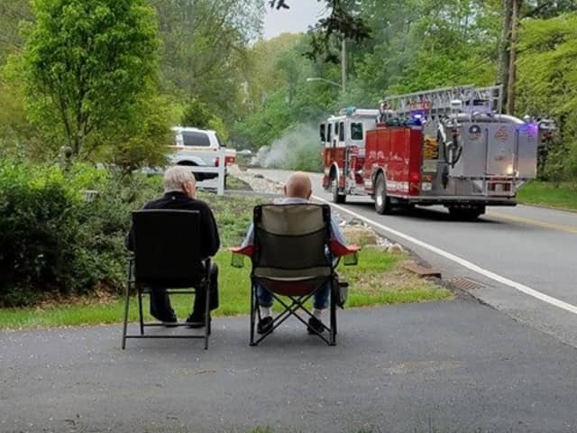 Firefighters work to restore power in Mahwah Saturday.