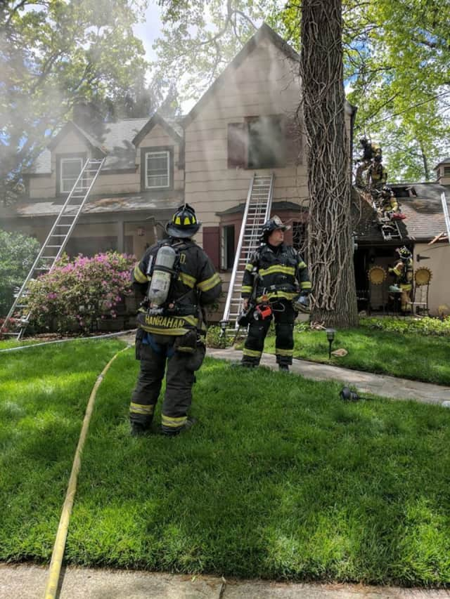 Hackensack firefighters work a Teaneck blaze Monday.