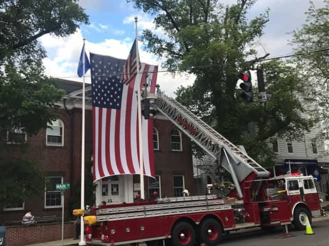 The Ridgefield Volunteer Fire Department hangs the flag at Town Hall for Memorial Day.