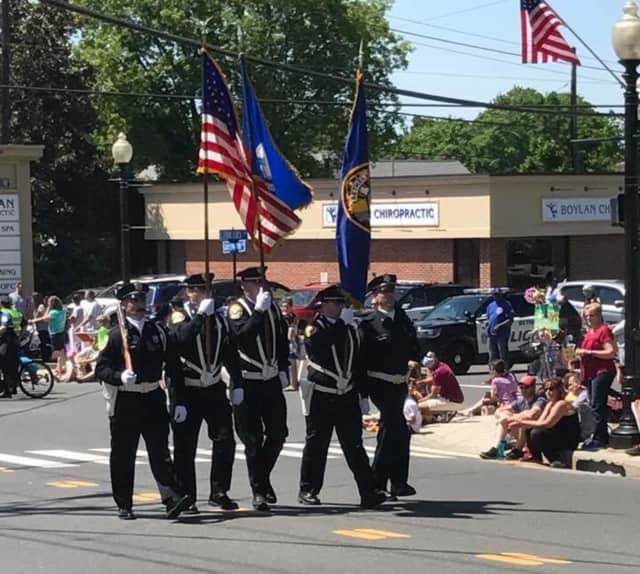 The police honor guard steps off at the front of Bethel's annual Memorial Day Parade held Sunday.