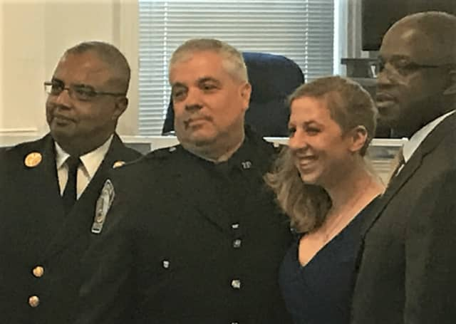 Ashley Hahn, with (from left) Fire Cheif Anthony Verley, her father, Police Officer Edward Hahn, Township Manager William Broughton.