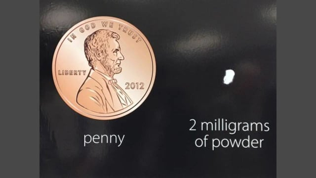 The deadly opioid Carfentanil is often disguised as heroin. This shows what a lethal 2 milligram dose of Carfentanil looks like when compared with a penny.