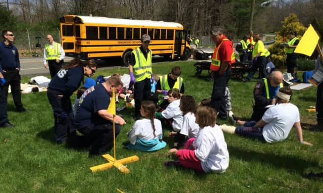 Ringwood Ambulance Corps members teach kids safety precautions.