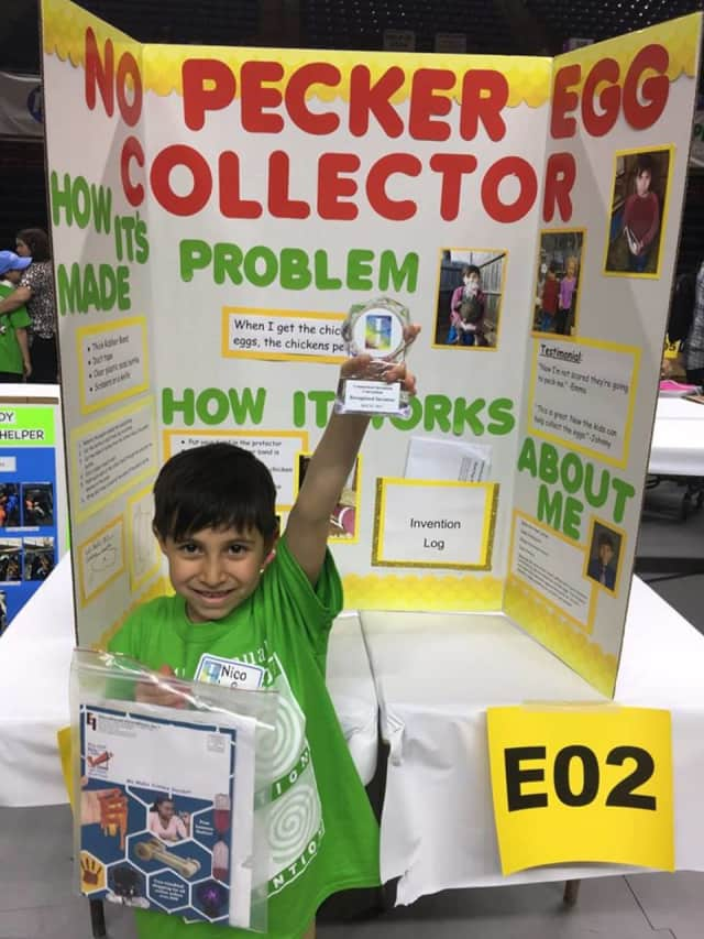 Nico LaRosa, a kindergartner at King Street Primary School in Danbury, shows off his project.