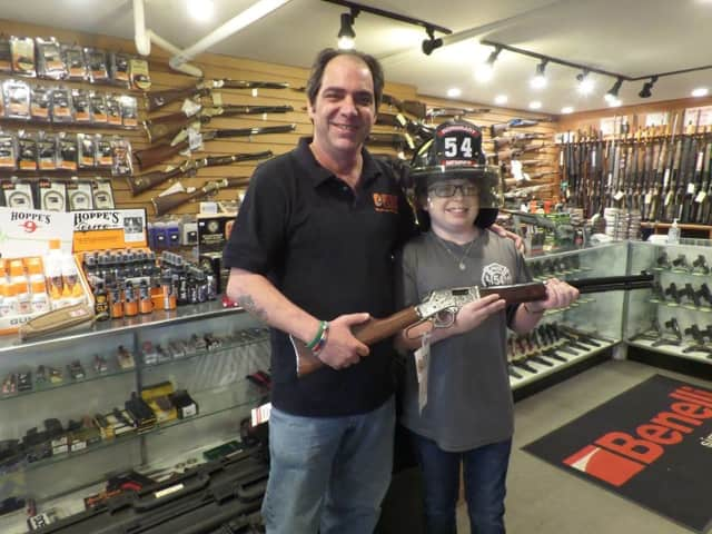 Joe Petrucelli and Joshua Brennan at the Tri-County Sporting Goods store.