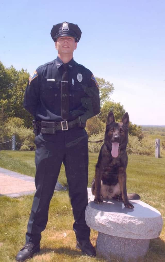Jager, a retired Shelton Police K-9 officer, has passed away. He is shown with his partner Detective Christopher Nugent.