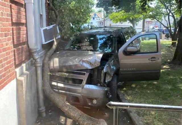 The Chevy Suburban crashed through a fence before slamming into the Washington School building in Saddle Brook.