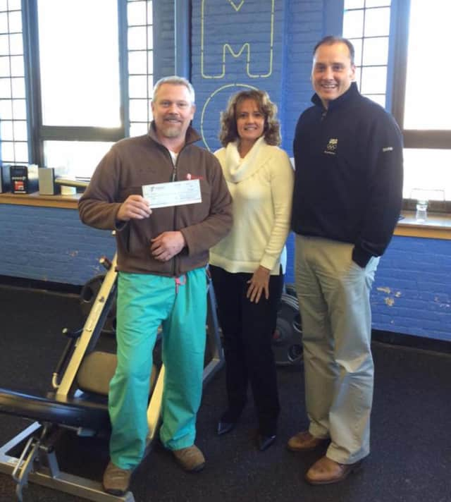 Louis Spaldo, Patricia Gallagher, Garfield YMCA CEO, and Charlie Gallagher, who sold the winning ticket.