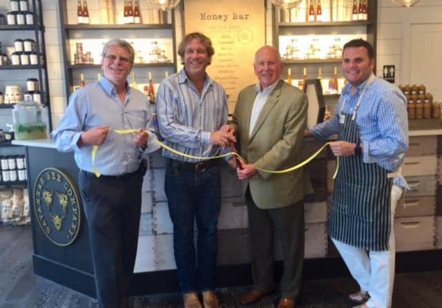 First Selectman Jim Marpe and Chamber of Commerce Executive Director Matthew Mandell join founder and owner Ted Dennard and Bob Kemp, head of retail, at the ribbon cutting for the Savannah Bee Company.