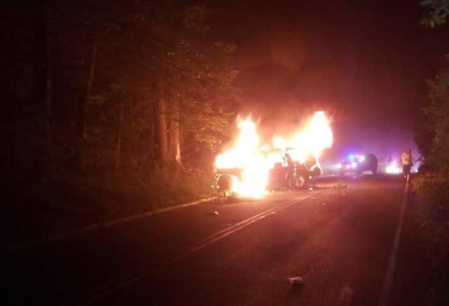 A man was pulled to safety by Spring Valley police after his car burst into flames following a police chase and wreck.