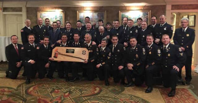 Wyckoff Protection Engine Company No. 1 with their inspection trophy.