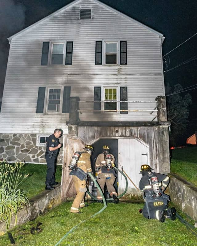 New Hackensack firefighters responded to a fire on Kent Road that displaced six families.