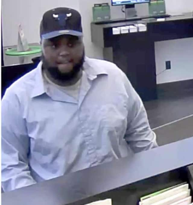 A tall heavily built man with a scruffy beard robbed the TD Bank in Westport on Sunday afternoon.