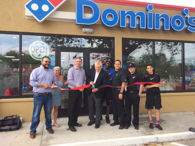The ribbon-cutting at the new Domino's Pizza in Bethel on Saturday morning.